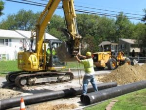 Ductile iron main is the material of choice today; shown, Milford Water Company water main install; design, construction administration, and resident observation by Tata & Howard
