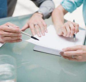 business_hands_notepaper_pens
