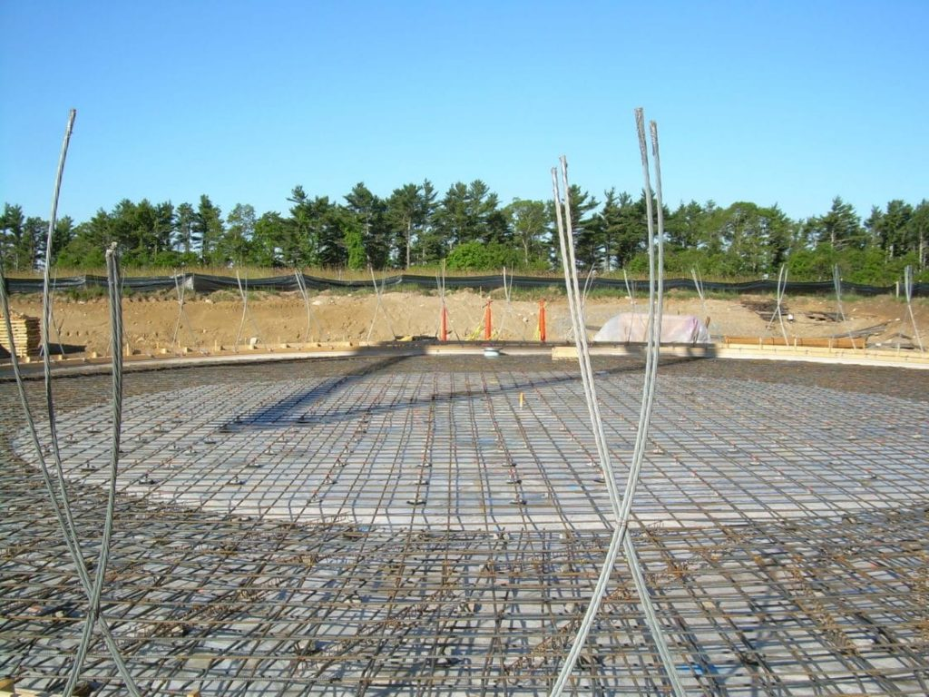 Tank floor/footing reinforcing steel and seismic cables prior to concrete pour