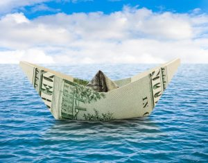Business concepts - ship from dollar money on water