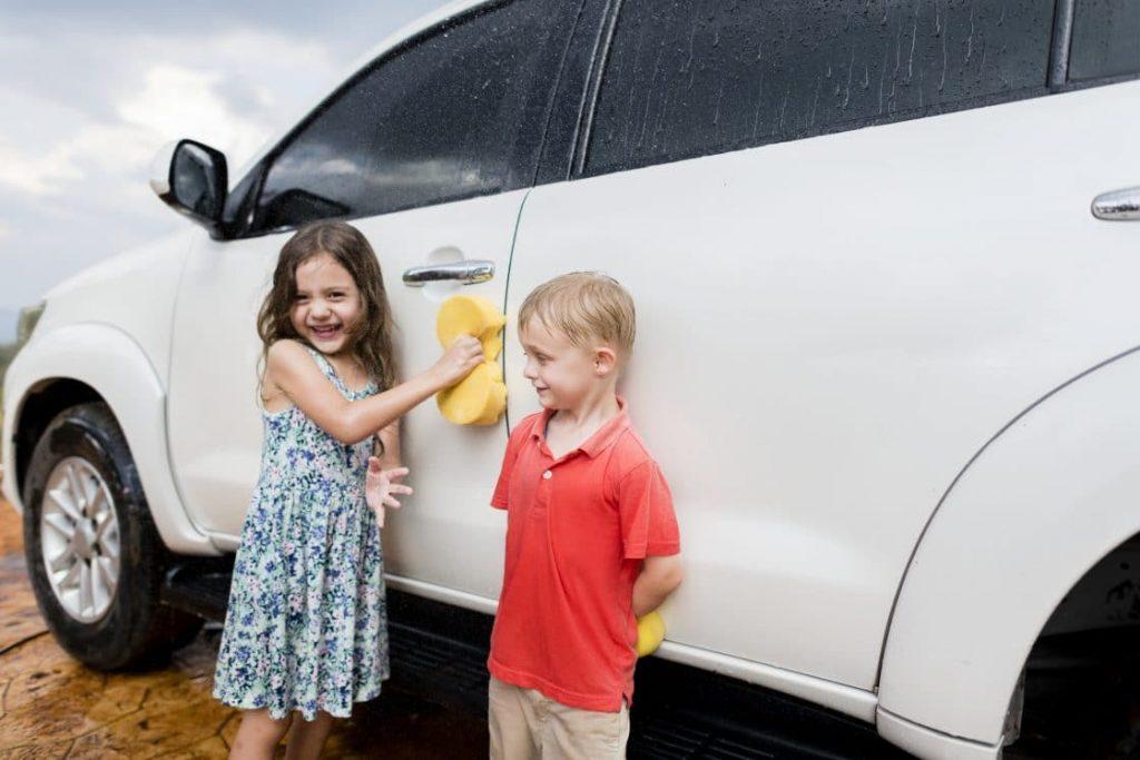 kids washing car at home