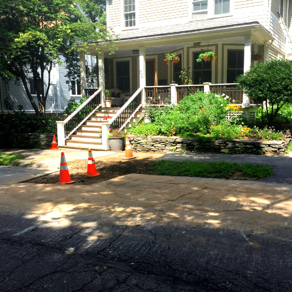 Lead service replacement program in Newton, MA. Newton home with construction cones.