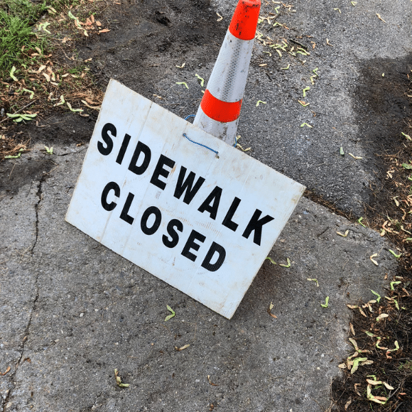 Lead service replacement program in Newton, MA. Sidewalk closed sign,